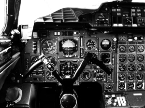 The complicated cockpit of concorde in black and white