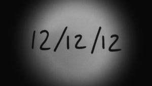 Vigonorette image of the numbers 12/12/12 written on paper
